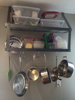 Hanging pots is the key to happy pots and a happy kitchen. I dislike clanging, awkward pots in cabinets.