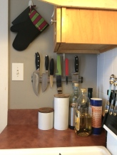 There's no space for a knife block, so a magnetic wall-strip works well.