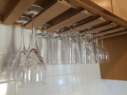 The apartment came with an over-sink rack, so buying stemware that fit it was an easy solution.