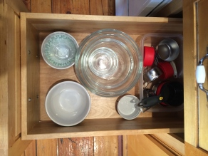 Mies and mixing bowls are next to the sink for easy prep.
