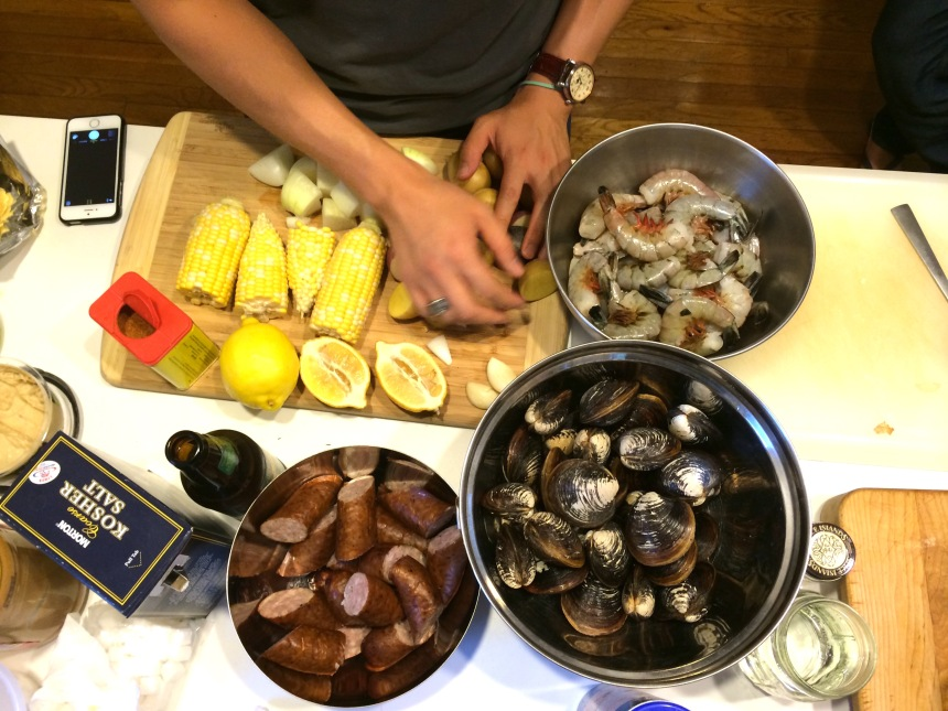 My friend Austin preps for a clam bake we made in his backyard.