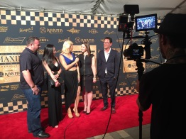 Going to the Maxim Indy 500 party, Theodore Racing crew interviewed on the red carpet.