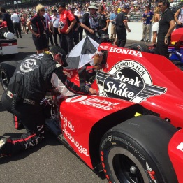 Taping up the car before the start of the race.