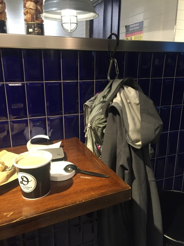Hanging up my jacket at a crowded eatery in Manhattan, New York, NY