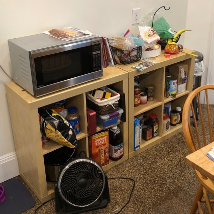 Before: A messy kitchen shelf by the mudroom.