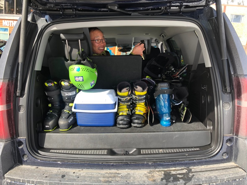 Jin with a full trunk of ski gear.