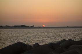 Watching the sun set behind a crane... very Dubai.